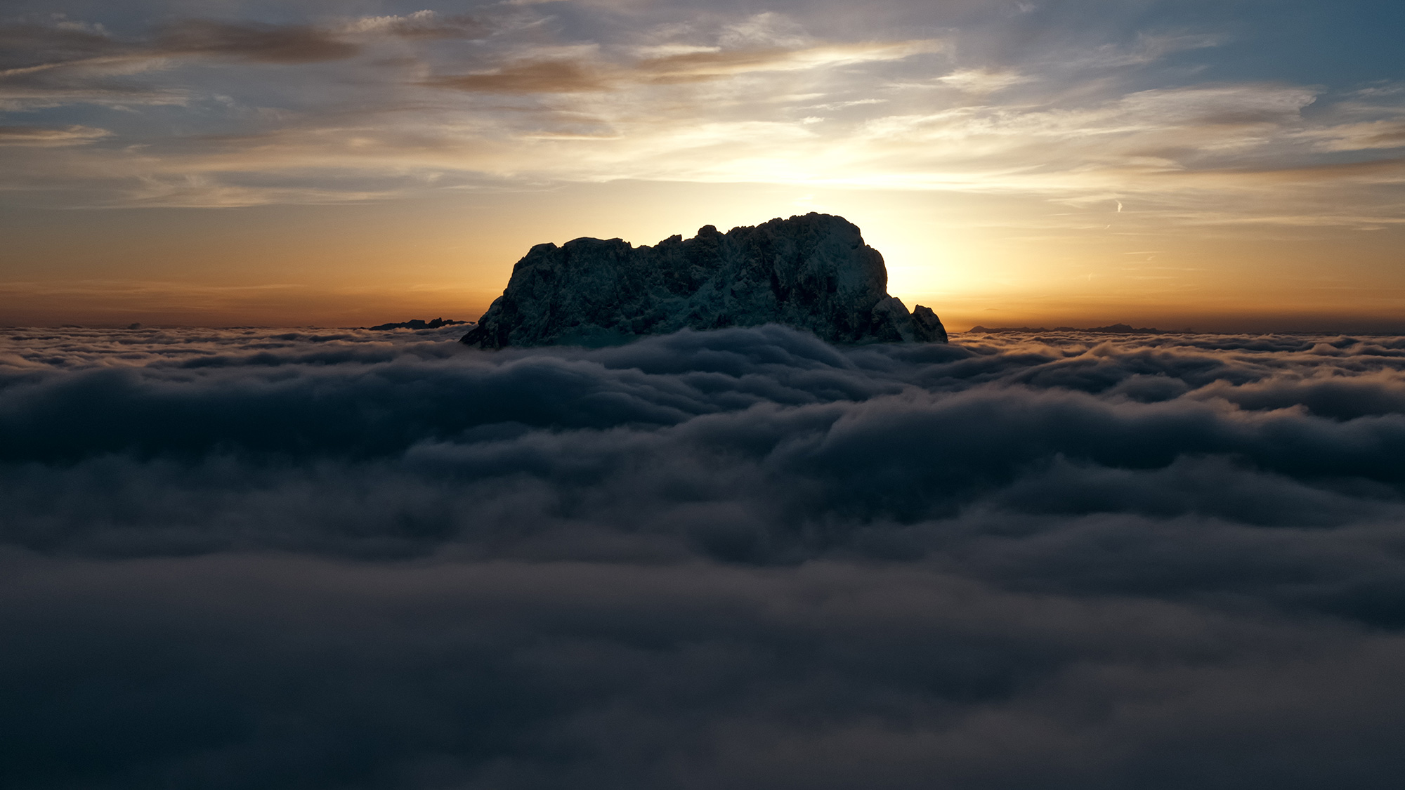 Sassolungo above the clouds